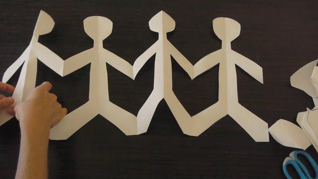 Make paper dolls holding hands