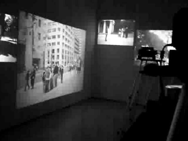 Room With Projector Screens On Every Wall