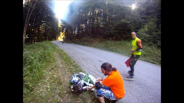 Longboarder hits grass at a high speed