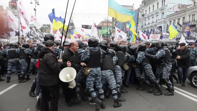 Supporters of Yulia Tymoshenko clash with police near the City districts court in Kiev