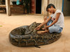 Snake boy in Cambodia - kid rides giant python