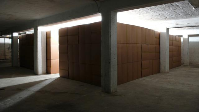 """111 prepared DC motors, cardboard boxes 60x60x60cm"" (2010/2011) by Zimoun"