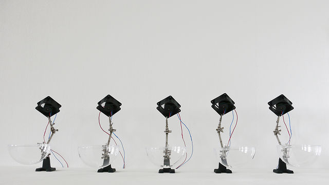"""5 ventilators, 35 styrofoam balls, 5 helping hands, air"" (2009) by Zimoun"