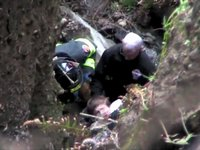 Boy survives fall down bluff