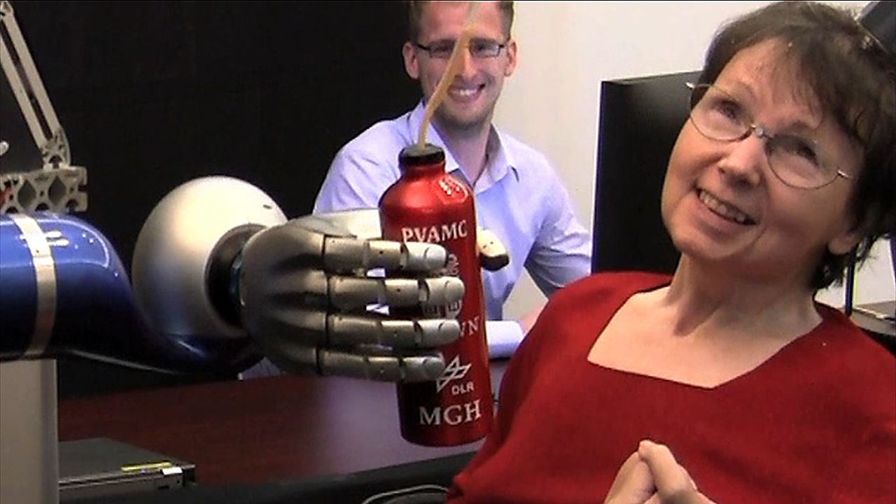 Paralyzed woman uses thoughts to sip coffee