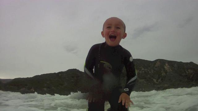 2 Year Old Surfing His First Wave