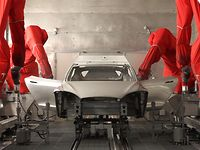 Watch How Tesla Uses Robots To Paint Cars