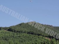 Paragliders Soaring Over Mountain