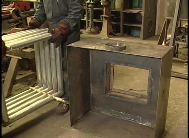 Tierra adentro viendo cocina caldera a le a for Estufas de lena usadas
