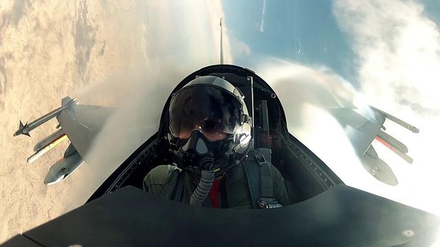 Blair Bunting rides in an F-16