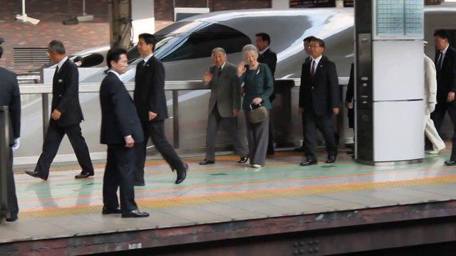 Emperor Akihito and Empress Michiko Give Us a Wave