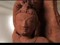 Red sandstone sculpture of an Apsara
