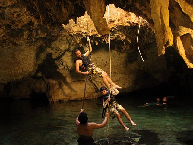 Swim in an underground river + jungle zipline