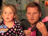 Daddy and Daughter Sing Against Fireworks