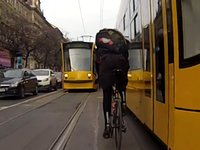 Insane Cyclists In Budapest Risking Their Lives Between Trams