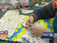 A Group of Older Women Make Plasic Bag Mats for the Homless