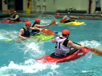 Goofing water polo in a kayak