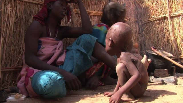 Crisis in Darfur Expands: Feeding Baby Izzedine