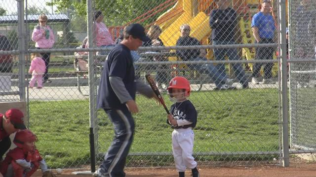 little guy playing baseball