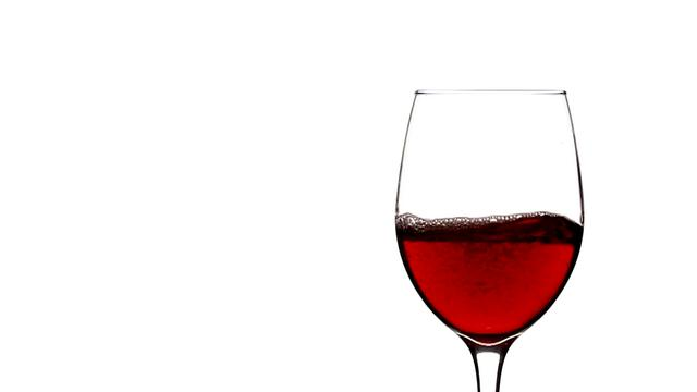 Pouring Red Wine Into Empty Wine Glass in Slow Motion